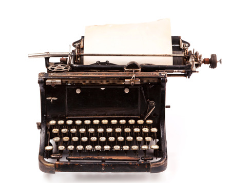 old fashioned, vintage typewriter with a blank sheet of paper Standard-Bild