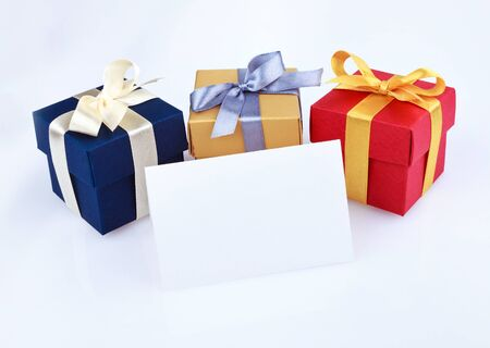 Greeting card with colored gift boxes Foto de archivo