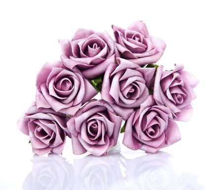 purple roses: artificial bouquet of purple roses on a white background Stock Photo