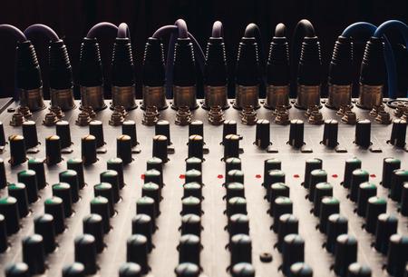 soundboard: Knobs of a studio soundboard with cord jack Stock Photo