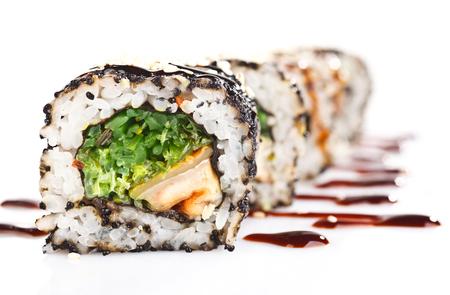 SUSHI: Traditional japanese sushi  with sauce isolated on white background