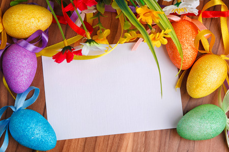 Easter greeting card with flowers and colorful eggs photo