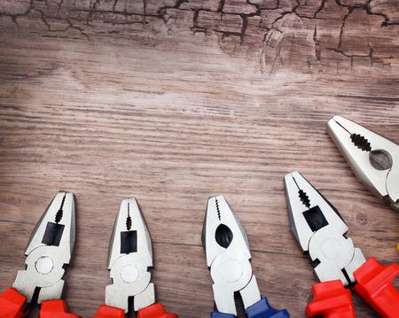 handtools: copyspace image set of handtools pliers on vintage wooden board construction concept