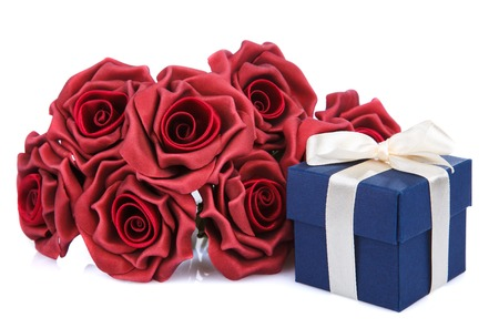 blue gift box: red flowers and blue gift box with ribbon on a white background Stock Photo