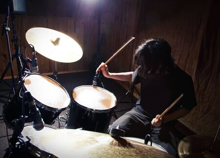 bass drum: drummer playing his drums set Stock Photo