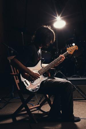 hairy guy playing bass guitar