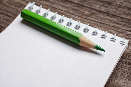 pensil: notebook with pensil on wooden background
