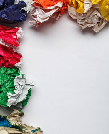 tex: crumpled colorful paper and white paper card  on wooden background, place for tex