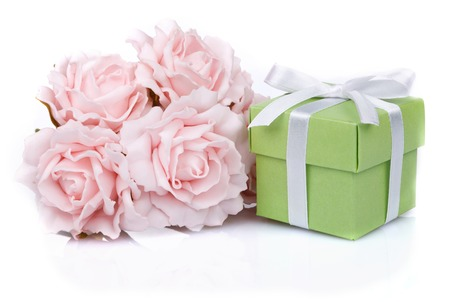 birthday bouquet: pink flowers and green gift box with ribbon on a white background