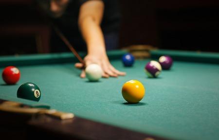 billiards cue: Playing billiard - Close-up shot of a man playing billiard