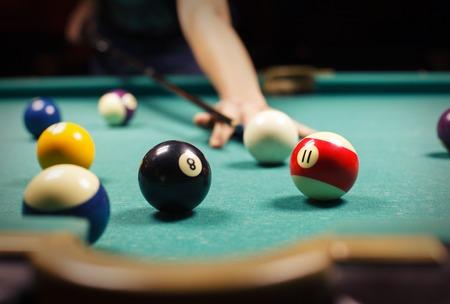 snooker halls: Playing billiard - Close-up shot of a man playing billiard