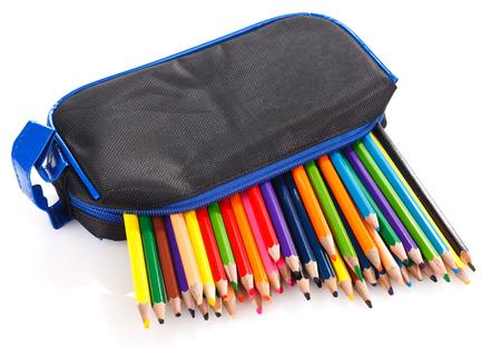 pencil case: color pencils in pencil case on white background