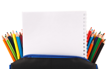 Notebook and color pencils with place for text