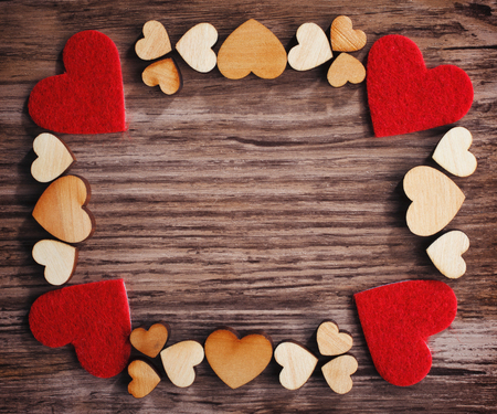 frame with hearts on a wooden board