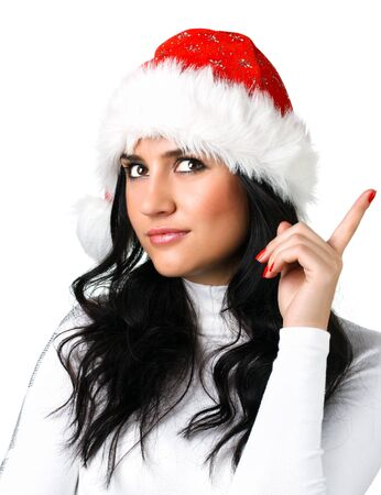 conceived: beautiful girl in a Santa Claus hat on white background Stock Photo