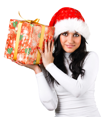 clothes interesting: beautiful girl in the hat of Santa Claus with a gift on a white background Stock Photo
