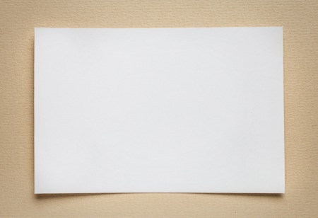 tex: white paper card on beige background, place for tex Stock Photo