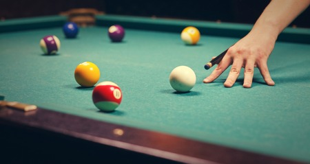 snooker hall: Playing billiard - Close-up shot of a man playing billiard