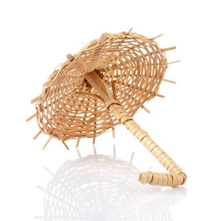 cocktail umbrella: Wicker Straw for cocktail umbrella isolated on white