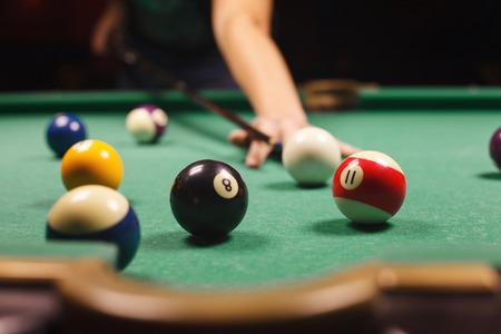 pool tables: Playing billiard - Close-up shot of a man playing billiard