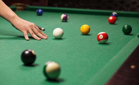 billiards halls: Playing billiard - Close-up shot of a man playing billiard