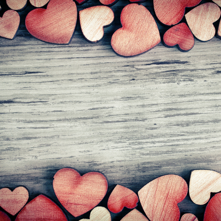 love: background with wooden  hearts, place for text