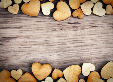 background with wooden  hearts, place for text