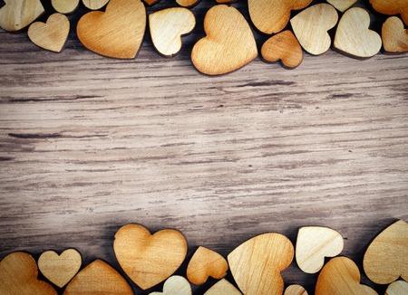 achtergrond met houten harten, plaats voor tekst