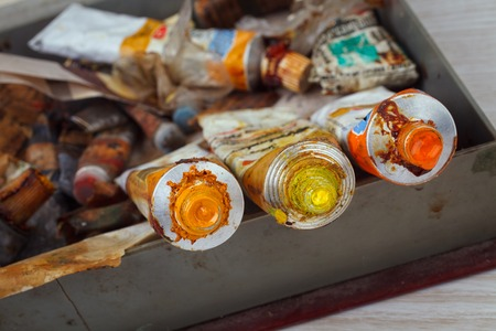 paint tool: Old Paint tubes on painted tool background Stock Photo