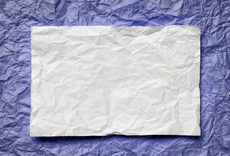tex: Crumpled  white paper card on violet  background, place for tex