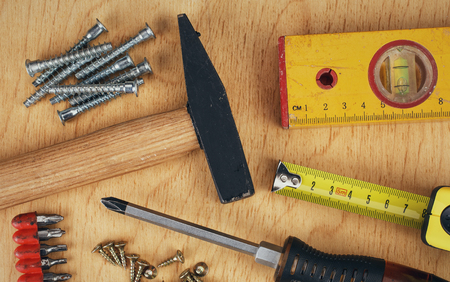 construction nails: construction concept  Set of manual tools on a wooden boards background