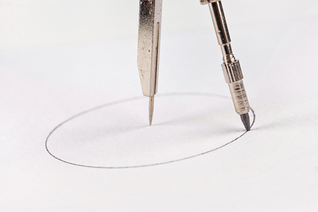 accuracy: compass drawing circle on a white paper