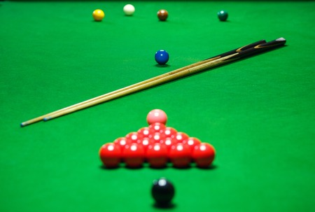 snooker balls: red snooker balls set on a green table, billiards game
