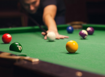 Playing billiard - Close-up shot of a man playing billiard