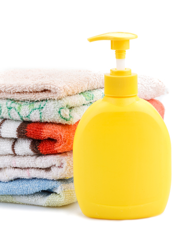 colored bottle: Towels and Soap Dispenser isolated on white