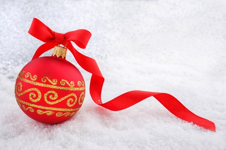 ribon: Christmas decorations Red Christmas ball with ribon in the snow