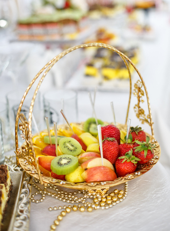 Beautifully decorated Banquet table with fresh fruit. corporate event or wedding celebration.