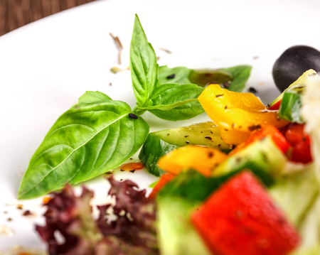 salad, food, appetizer and greek concept - Traditional greek salad with fresh vegetables, feta cheese and olives.