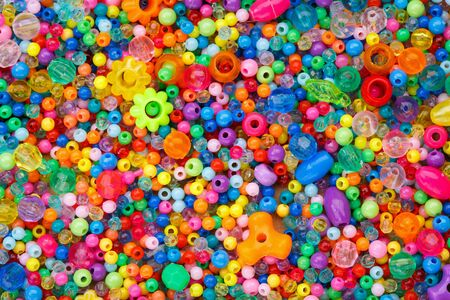 Lots of colorful fusible plastic beads used for arts and craft