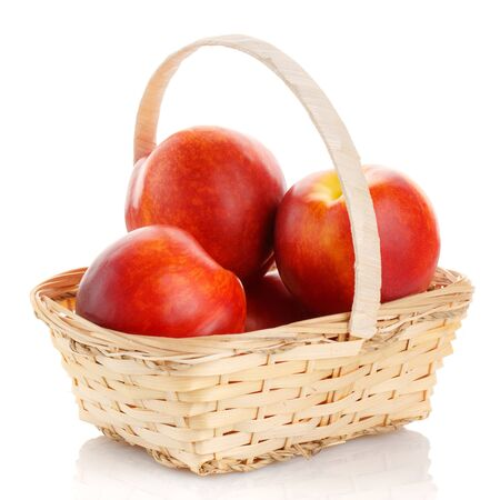 Fresh peach fruit in basket isolated