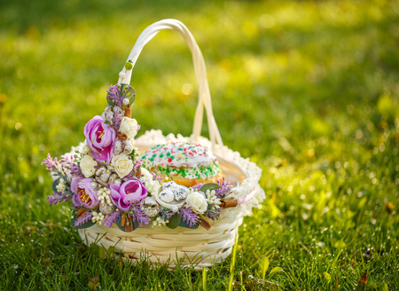 Easter basket on the grass in the garden Stock Photo