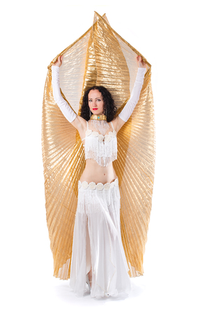 Beautiful slim woman belly dancer.Professional artist in carnival shining costume with long hair. Exotic star of bellydance.