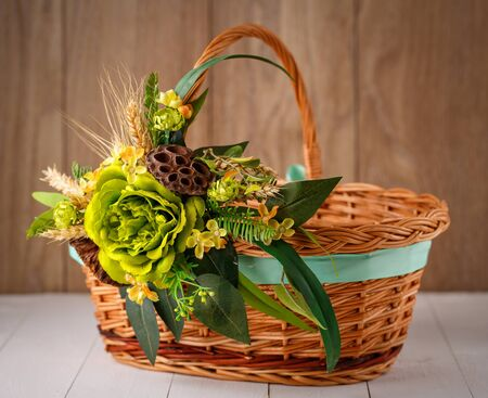beautiful basket is decorated with a flower arrangement for the celebration of Easter
