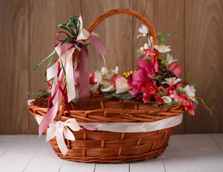 Originally decorated by flowers basket on a wooden background