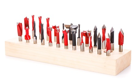 large set of drill bits for wood in wooden stand on a white background Stock Photo