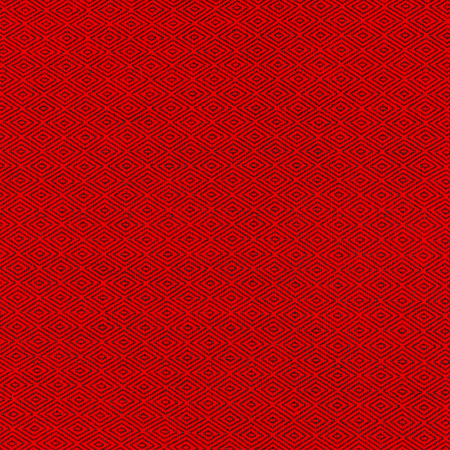 Fabric of red color for warm autumn dress or skirt.On the fabric is a picture in the form of black rhombus Stock Photo