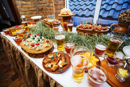 The table is prepared for watching football: fragrant snacks and beer