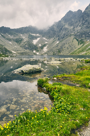 Hincovo pleso. High Tatras Slovakia Europe. Pure lake with a rocky bottom on the background of the mountains of the High Tatras
