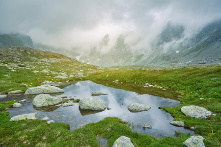 Hincovo pleso. High Tatras Slovakia Europe. Pond against the background of the mountains in the fog.