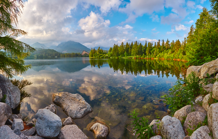 Lake in the High Tatras in the rays of the evening sun on a background of mountains